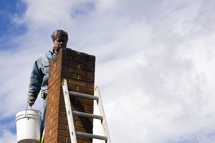 a brick chimney with a ladder