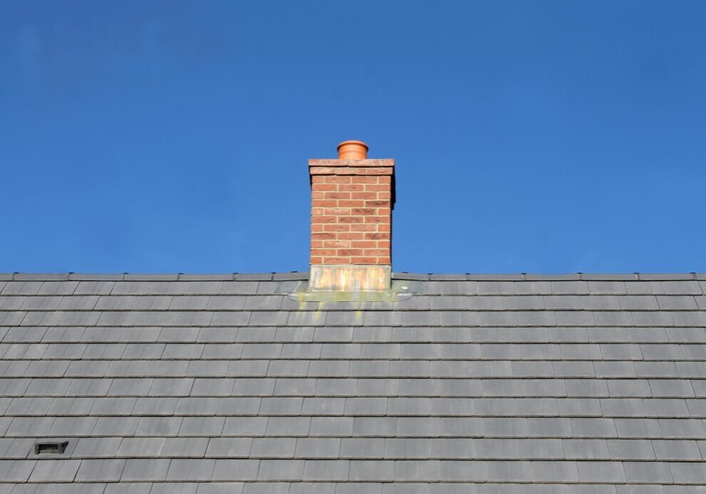 a chimney at the center of the roof